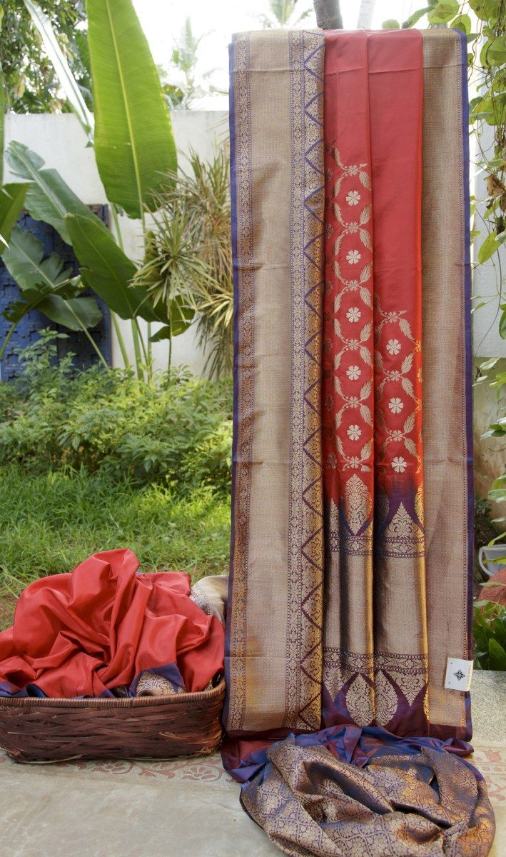This Benares silk is in cherry red with a pattern in gold zari only towards the pallu. The complementing border and pallu are in dark indigo with intricately woven gold zari making it unique and un...
