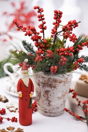 Red berries and greenery in clay pots christmas