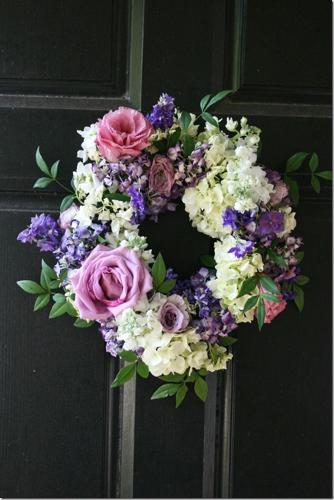 wreath of fresh flowers ~ Would be pretty hanging on the doors of a church. These are larger than the pew ends and therefore may make more of an impact at the church - These can be easily placed flat on a table and then have candles added to them too - might be able to use on side door and then reused on outdoor coffee table
