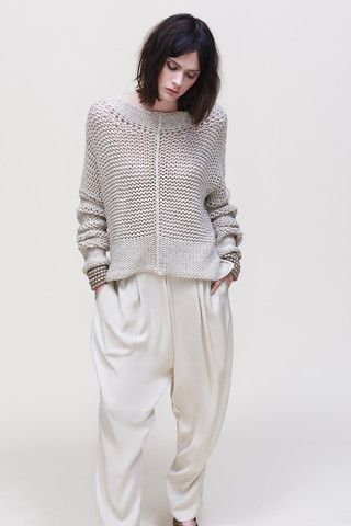 This wool sweater and cotton pants give two different textures and appear to be a very comfy outfit.