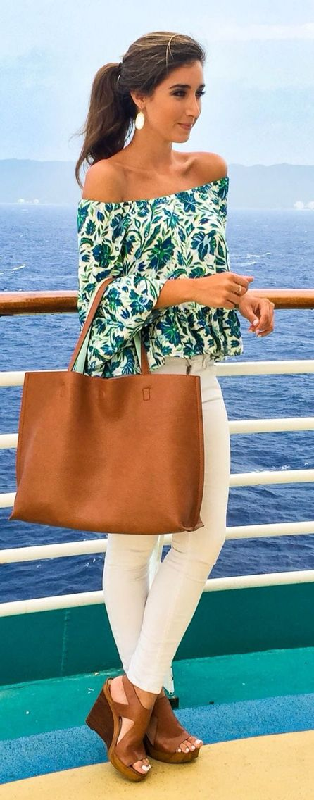 Palm print off shoulder top, white jeans, oversized tan tote, and Michael Kors Josephine wedge heels in luggage. Lovely summer or cruise ship outfit!