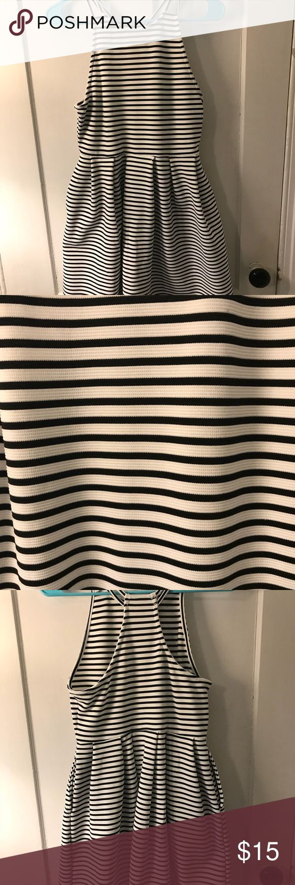 Black and white striped formal dress Wonderful material, stretchy, perfect for a holiday outfit, the top is tight and the bottom is flowing. Has two pockets as picture! Accepting offers! SO Dresses Midi
