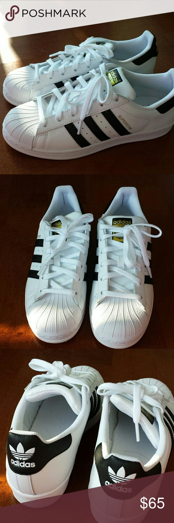 Adidas black white superstar striped sneakers Basically new Adidas superstar sneakers.  Worn for about 10 minutes before I decided I needed to size up.  These are size 6.5, but they run big.  Please know your sizing! Adidas Shoes Athletic Shoes
