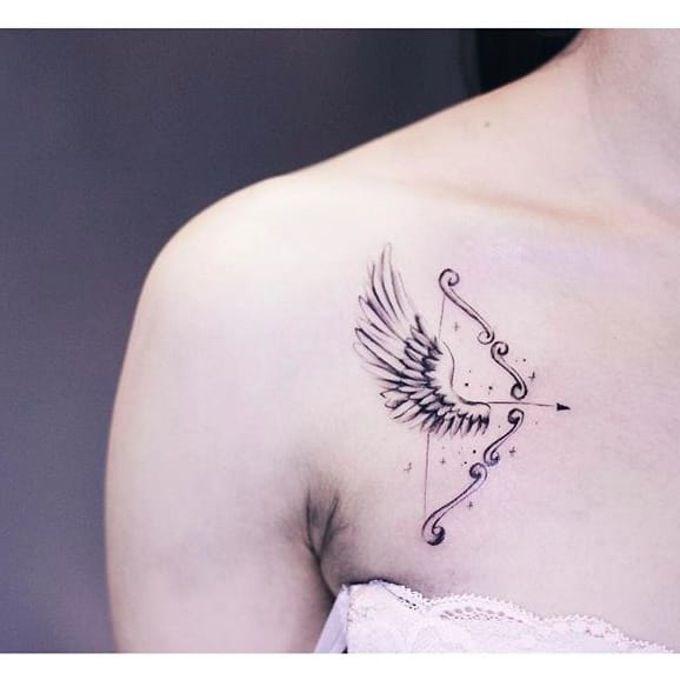 Subtle arrow tattoo combined with a wing design via Instagram @helenxu_tattoo #linework #subtle #arrow #wings #HelenXu #finelines