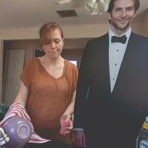 He helps around the house. | This Mom Started An Instagram Account For Her Cardboard Cutout Of Bradley Cooper