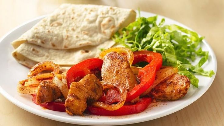 Have fun with these no-fuss fajitas, with chicken, spices, and vegetables cooked on the grill in easy-clean-up foil packets.