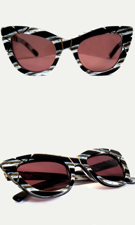 Hand-sculpted detail and striped horn frames make this glamorous style feel both classic and new. Wear these statement sunglasses all season to add a bold tribal touch to any outfit.
