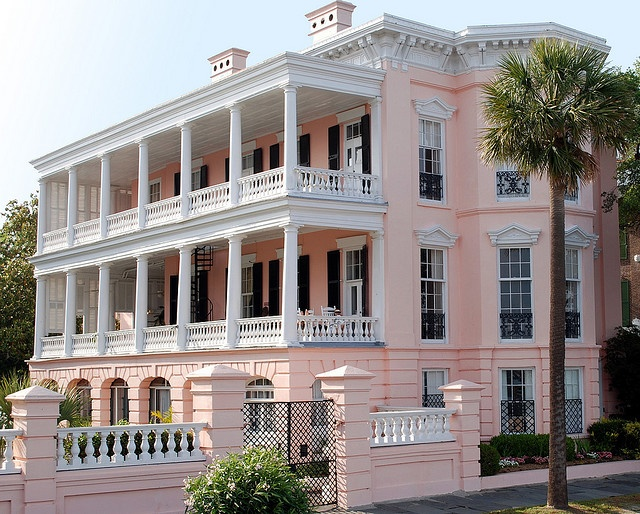 "The Palmer Home.  High profile mansion on the battery.  It is an example of a  Charleston single house.  The definition of a ""single house"" is that the house is one room wide. Frequently a side porch, called a ""piazza is"" featured .  These  piazzas can have multiple levels.   From the piazza at The Palmer House, guests can see the Charleston Harbor and Fort Sumter."