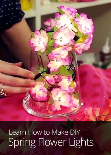 Looking for a DIY project to upcycle your old Christmas lights? Learn how to make make flower lights with plastic flowers and a string of holiday bulbs.