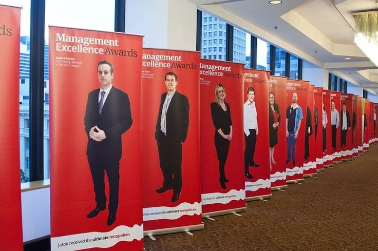 Retractable banner stands for an indoor event.