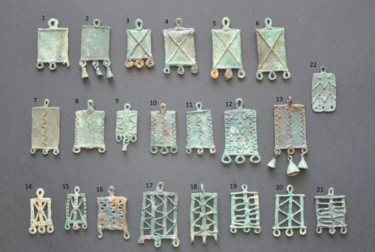 Amlash bronze pendants with numbers, 1st millenium B.C. Private collection