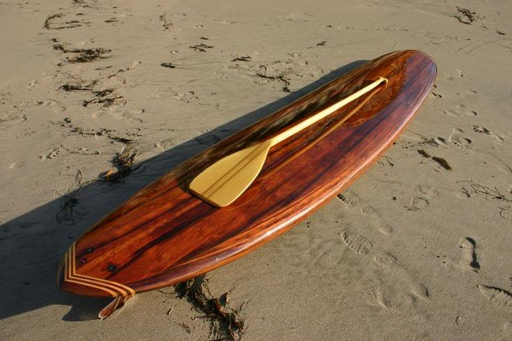 Beautiful SUP and paddle from reclaimed wood.