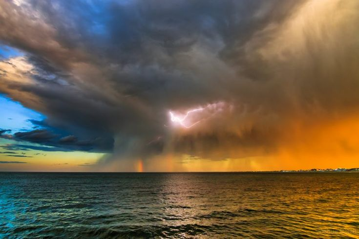 As autumn unfolds … remember last summer? Josh Blash captured this cool image in June, showing a summer storm in the Atlantic, just off the coast of New Hampshire.