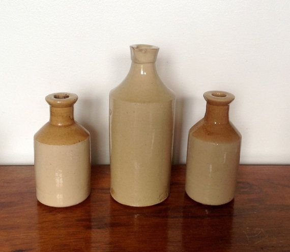 A collection of three Stoneware Saltglaze pots/bottles, from the early 20 th Century.  The largest bottle has a pouring spout and is 8 tall, 3 diameter, and is stamped..  Doulton. Lambeth. It has a chip on the base and a small chip on the spout ( see pics)  The two smaller bottles are just over 5 tall and 2.5 diameter. Both have very small chips at the top ( see last photo )  Over all these are an attractive set of Stoneware bottles with signs of their age, giving character and charm…