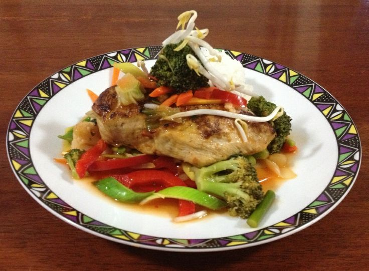 Spicy Chicken Breast filled with Asian Vegetable served  on Rice with Sweet & Sour Sauce and Vegetables
