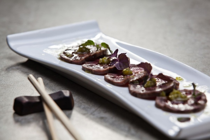 Miso No Shikichi  sashimi of rare wagyu marinated in white miso paste for one week, seared on charcoal, served with unique kizame wasabi dressing, Sanchao pepper and miso powder