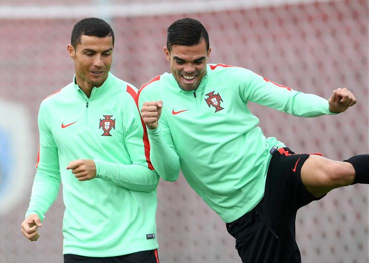 Cristiano Ronaldo of Portugal shares a joke with Pepe during a training session at Stadium Rubin on June 27, 2017 in Kazan, Russia.