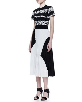 Stark color contrasts and geometric blocking make for a bold statement. Proenza Schouler, 212 872 8835
