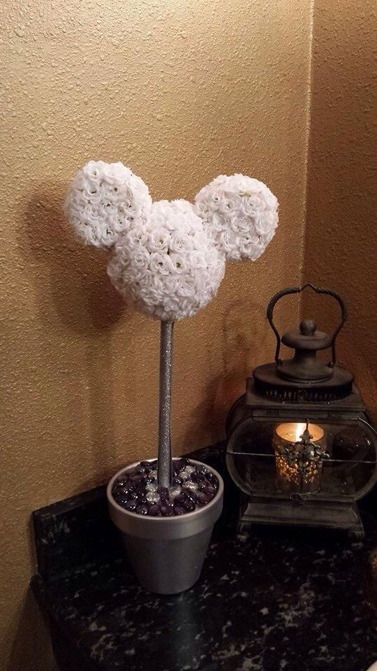 DIY disney center pieces/ Hidden Mickey/ hidden Mickey flower/ disney wedding/ center piece for disney wedding/ hidden Mickey from my at home disney wedding. Used styrofoam for head and ears then hot glued little flowers to styrofoam mold.