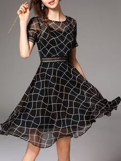 Black Geometric Short Sleeve Midi Dress - If I was still out in the corporate world, this would be a must have.  Love delicate flow to it, yet classy look.  And I always love black. :-)