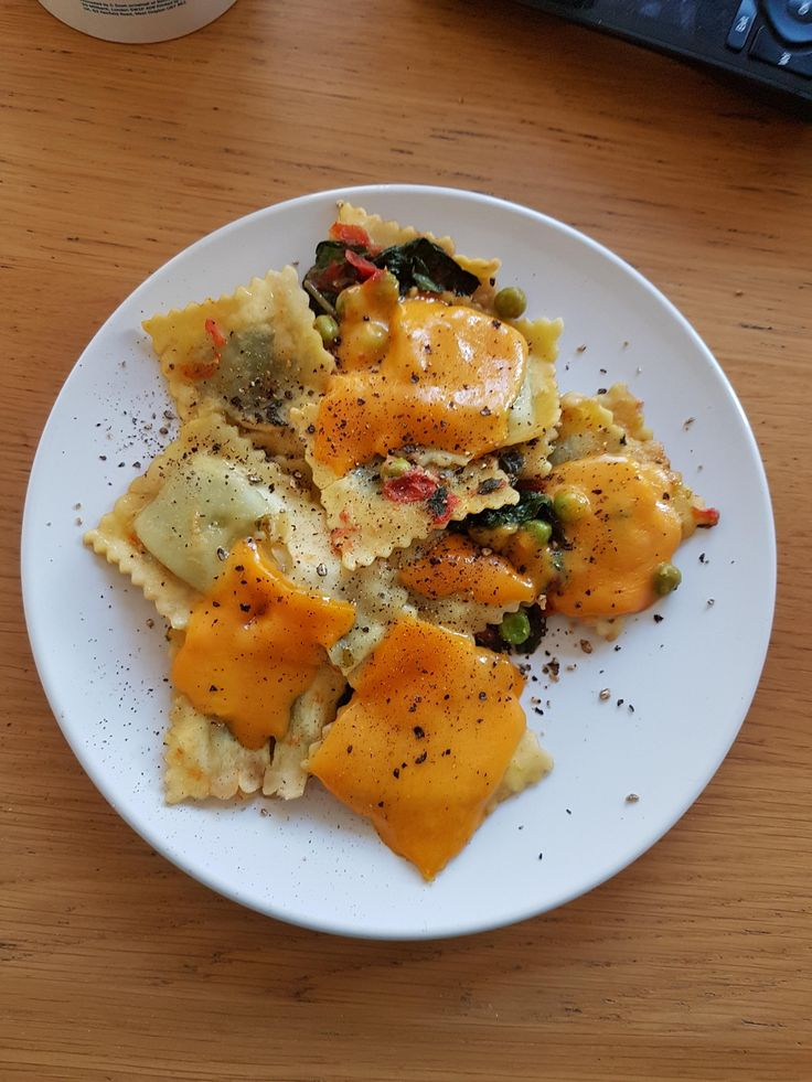 [I ate] Spinach and ricotta ravioli w/ peas chillies peppers and Red Leicester cheese
