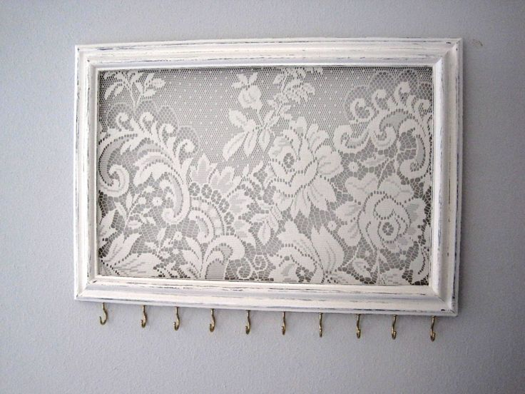 Jewelry Hanger / Organizer / Vintage Frame Distressed / Antique White W/Lace / Hooks. $30.00, via Etsy.