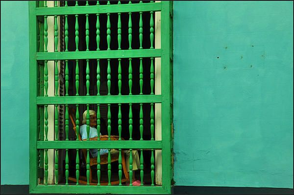 Old lady in Trinidad observing the tourists from her living room.