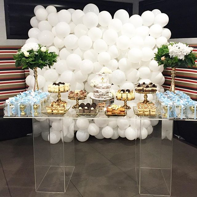 A beautiful dessert table display by @events_by_rachael. Acrylic table by @elegant_tea_time Balloon Wall by @bubblemooballoons Desserts by @phbakes Cake by…
