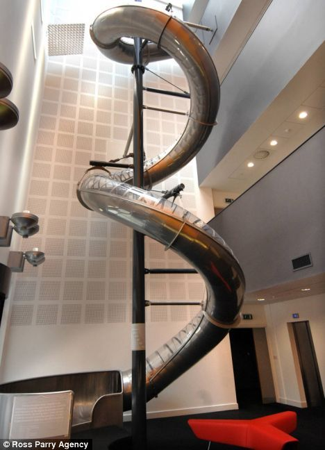 """A 3-story """"helter skelter"""" slide at the Electric Works office in Sheffield, U.K. I love this, I do. Ppl think they'd love to work somewhere that had things like this but then whenever the economy takes a downturn, the companies are slammed for frivolous spending on 'things like these'. Can't win."""