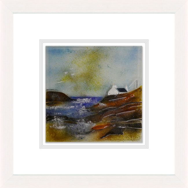 'Coastline Cottage' by Edel Taggart. This piece has been hand crafted, fused & framed by Spires Art in Omagh. Available in size 24in X 24in.