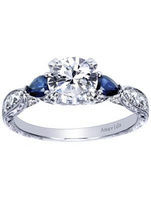 The Sapphire Side Stone Love Kate Middleton's ring but still want a diamond? Stick with some sapphire side stones for a pop of color. Engagement ring by Gabriel & Co.