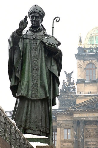 Statue of St. Adalbert (sv. Vojtěch), second bishop of Prague, on a monument with equestrian statue of the king St. Wenceslaus (sv. Václav), Prague.