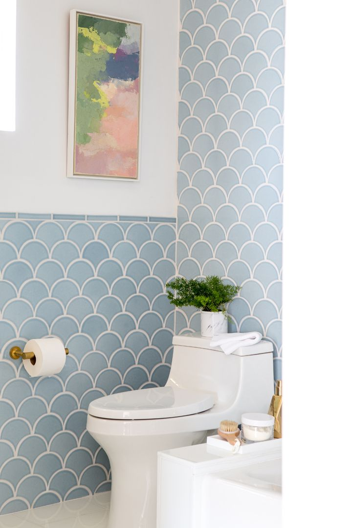 A soft Mid-Century Master Bathroom with soft blue tile.