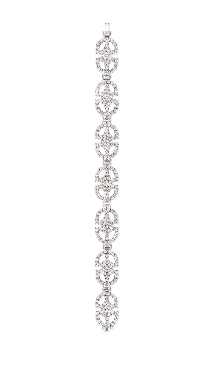 Harry Winston Unveils Art Deco Inspired Collection - The collection consists of a diamond sautoir, single and multi-motif diamond bracelets, single motif diamond earrings, a diamond pendant and a ladies jewelry timepiece using the same motif.