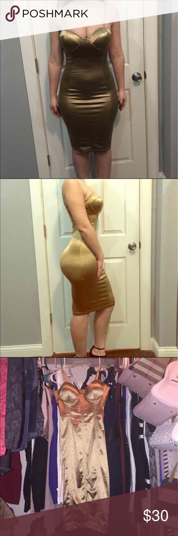 Gold bodycon dress Got all lot of compliments in this dress . Shows every curve in your body !!! Super sexy for any occasion. Wore a bracelet that got some snags on the dress other than that you can't tell while it's on , only if you pay close attention to it . Bundle and save . Not listed brand just for exposure Guess by Marciano Dresses Midi