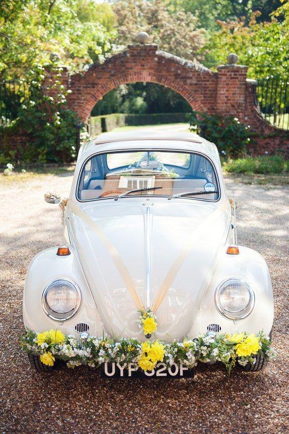 vintage wedding car decorations / http://www.himisspuff.com/ways-to-decorate-your-wedding-getaway-car/5/