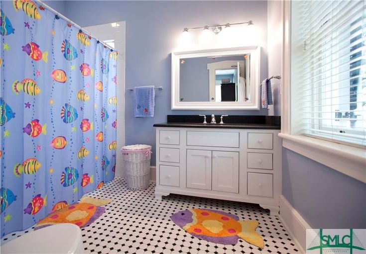 Traditional Kids Bathroom with Brantford 4 Light Vanity Light by Moen, Wall sconce, Carpet, Built-in bookshelf, High ceiling