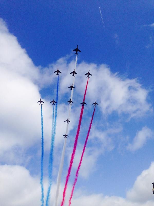 French Armée de l'Air's Dassault Dornier Alphajet trainers of La Patrouille de France, pass over Paris, July 14 2015.