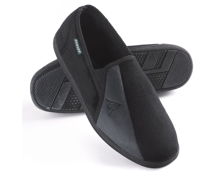Retro-styled house slippers in black and soft grey. Composed of soft velour textile on the outside and durable outsole for extra grip. Cosy felt textile lining and insole for warmth and comfort. Slip on with elasticated side gusset for a comfortable fit.
