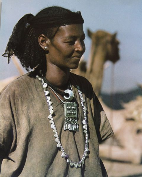 Africa |  An Oromo woman of Welo Province, Ethiopia, with a necklace of Telsum - small triangular and crescent-shaped pendants offering protection. |  © Angela Fisher