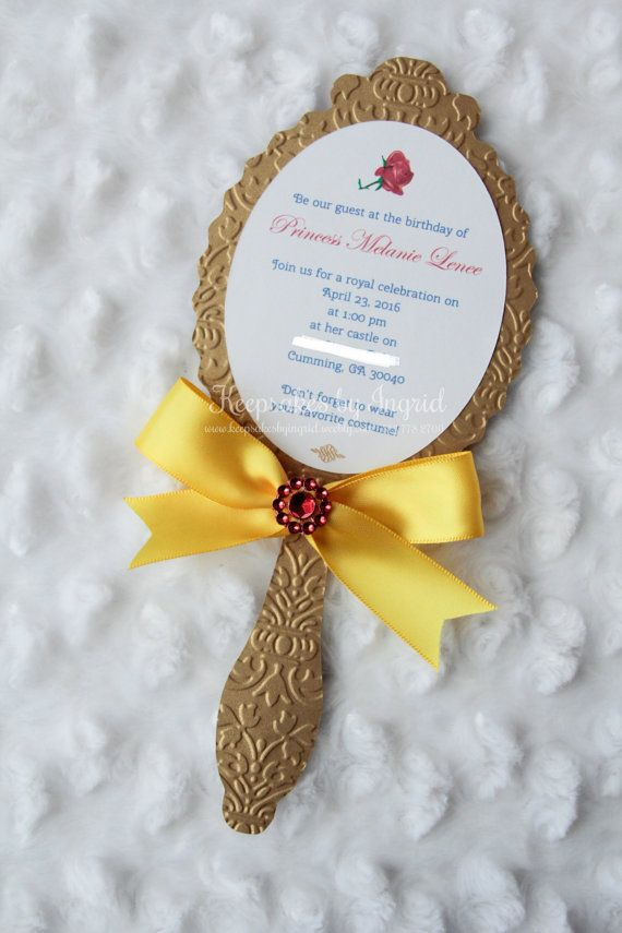 Set of 15 mirror invitations in embossed gold cardstock with yellow satin ribbon and sparkle detail on top. Perfect for a beauty princess party. Text is printed on white cardstock. Measures approximately 9 x 4. Does not include envelope. Handmade envelope available, if interested, please inquire  ***This is a custom made item. Be aware that it requires print and assembly time (between 4-7 days after final sample is approved)***  ***Please provide the details of your event and/or any specific…
