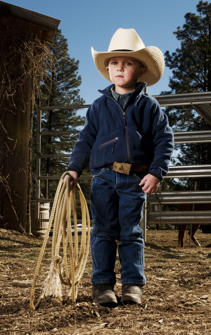 Image detail for -Portrait of a 3 year old boy, dressed in western attire and a cowboy hat, holding a lariat in front of a corral at his family's ranch in Flagstaff, AZ