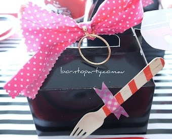 pirate party lunch box  tied with cute pirate bow with pirate earring for the littlie.. don't forget the cutlery taped on by washi tape   www.borntoparty.com.au