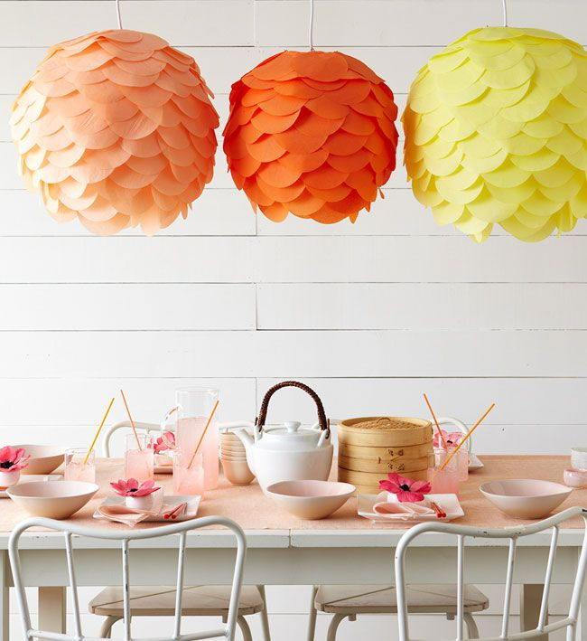 something like this for reception in wedding colors?  Or could make them look like giant rananculus flowers