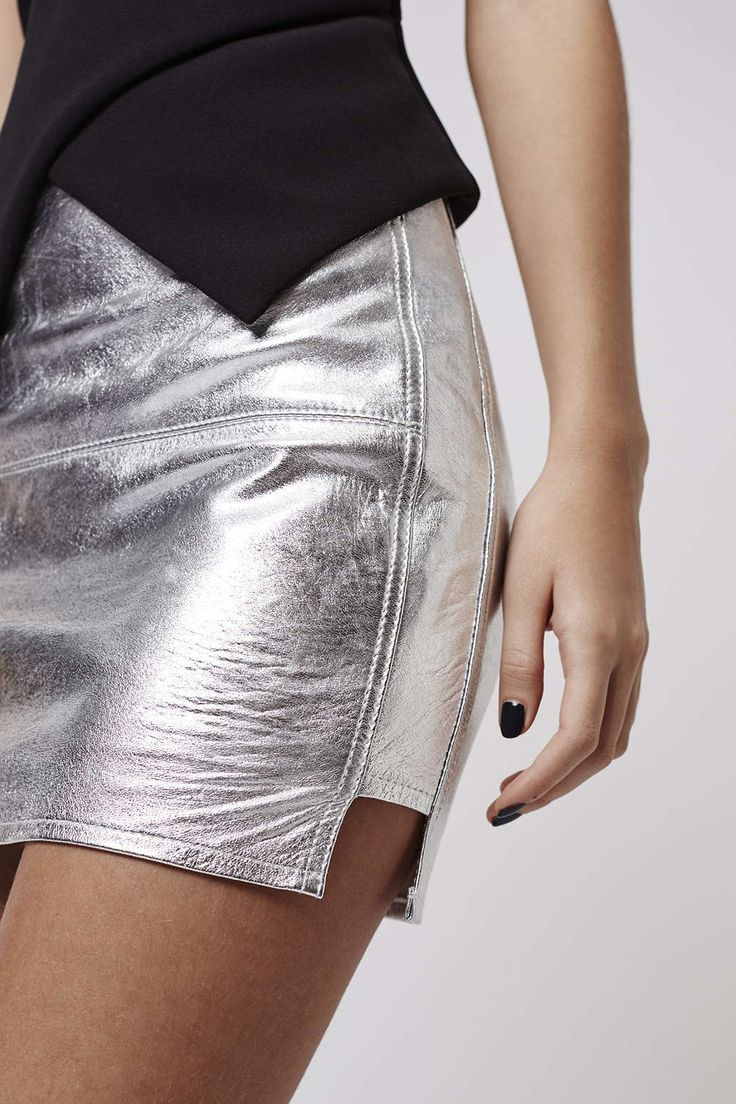 Leather just got a Kendall and Kylie style update. Think high shine metallic silver mini skirts paired with black bomber jackets. #Topshop #KendallandKylieforTopshop