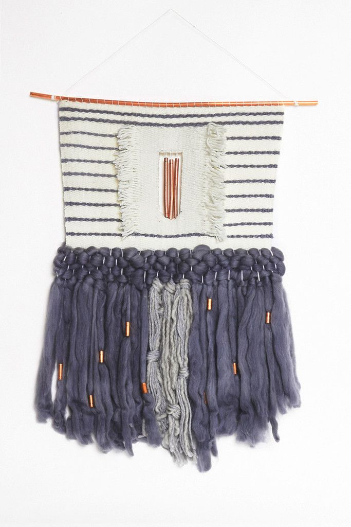 """- Woven with cream and grey wool yarn - Fringe is a tussah silk wool blend roving with copper detail - Hangs from a copper dowel Measures 18"""" wide by 22"""" long - Made-to-order only. Please allow 7-14 d"""