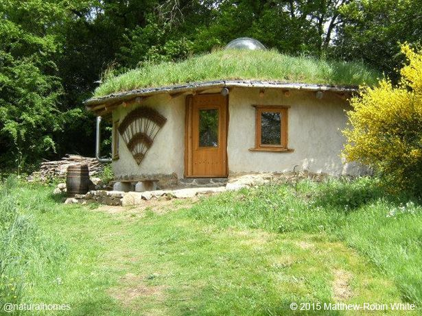 This is a French 7m diameter straw bale roundhouse inspired by the work of Tony Wrench. You can see 9 stages in its construction here www.naturalhomes.org/step-by-step-roundhouse.htm