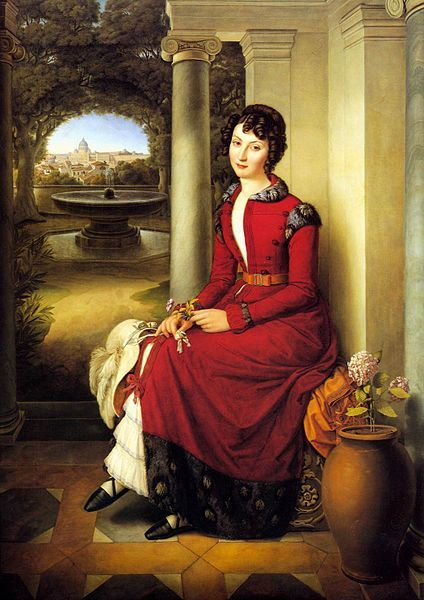 Marchesa Marianna Florenzi wears a fur-trimmed dress with a belt over a white ruffled undergown and carries a feather-trimmed bonnet, 1824