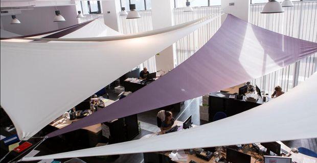 Interior shadesail I Batyline Aw acoustic membrane by Serge Ferrari