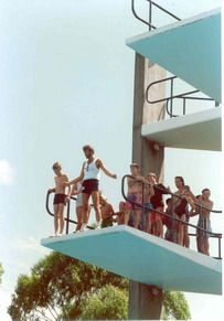 A trainer with students on the high diving tower at the Harold Holt Memorial Swimming Centre, 1988.